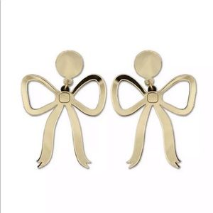 Gold bow statement earrings